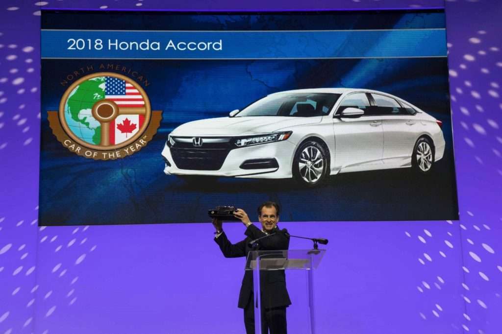 Henio Arcangeli, senior vice president of the Automobile Div. of American Honda Motor Co., and the 2018 North American Car of the Year award