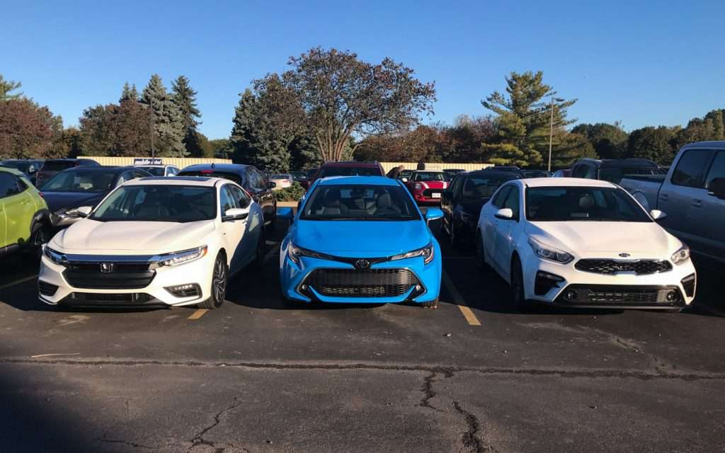 (l-r) Honda Insight, Toyota Corolla hatchback, Kia Forte - semi-finalists in the NACTOY Car of the Year category.
