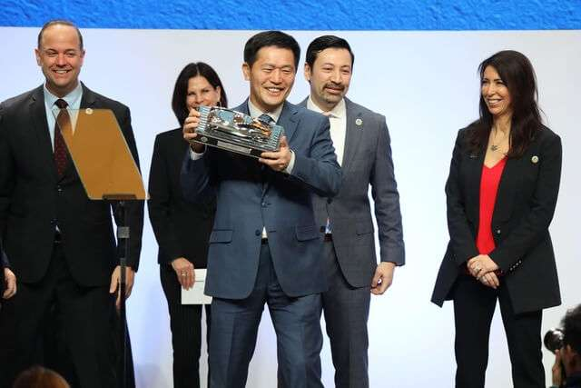 Mr. Kiim accepts the 2019 North American Utility of the Year award for Hyundai